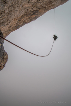 Abseiling off the wildly overhanging final pitch