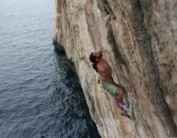 Alexander Huber climbing Il Capitano, Capo Monte Santo, Sardinia