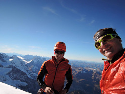 Kilian Jornet Burgada and Ueli Steck on the summit of the Eiger after having climbed the 1938 Heckmair route.