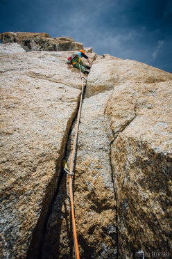 Federica Mingolla climbing the cracks on the Direttissima on Trident du Tacul, Mont Blanc