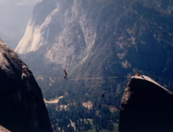 Scott Balcom making the first slackline crossing of the Lost Arrow Spire highline on 13 July 1985.