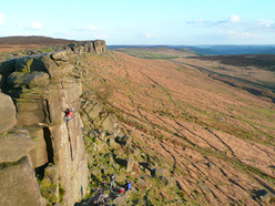 The immense gritstone outcrop Stanage Edge, with over 1300 routes dating all the way back to 1890.