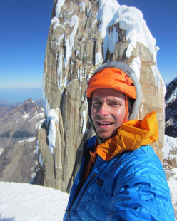 American alpinist Colin Haley on the summit of Torre Egger in Patagonia after having made the mountain's first solo ascent.
