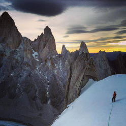 Sunrise on the South East Ridge of Cerro Torre as Colin Haley leads the rappels down after a long day of traversing the range together with Alex Honnold.