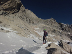Tom Ballard looking back at the south face of Piz Badile, the