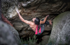 Charles Albert climbing barefoot at Fontainebleau in France