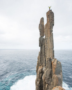 Jorg Verhoeven and Katharina Saurwein climbing the 4 pillars of Hercules at Cape Raoul in Tasmania