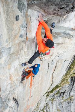 Simone Pedeferri climbing his route Adventure time up Meridiana del Torrone, Val Torrone, Val Masino, Italy