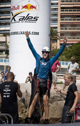 Christian Maurer celebrating at Lavotto beach in Monaco after winning the 2009 edition of Red Bull X-Alps.