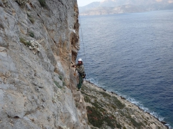 Alexandros Istatkof rebolting the climbs at Irox, Telendos, Kalymnos, Greece