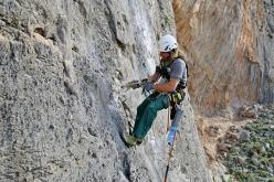 Alexandros Istatkof rebolting the climbs at Kalymnos, Greece