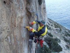 Claude Idoux rebolting the climbs at Kalymnos, Greece. Here at the Irox sector on Telendos