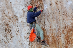 George Kopalides rebolting the climbs at Kalymnos, Greece