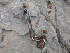 A rusty old belay at Kalymnos, Greece