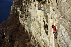 Silvan Schüpbach traversing after the roof during the first free ascent of Ultimo Sogno, Parete d'Osogna, Switzerland on 06/04/2016 together with Berne Emmerich