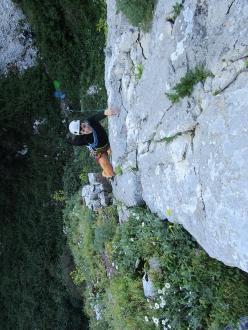 Giuseppe Barbagallo climbing the first pitch of Melodie mai perdute (220m, 7a+ max, 6c oblig Massimo Flaccavento, Arturo Latina) Pilastro Maurizio Lo Dico, Rocca Busambra, Sicily