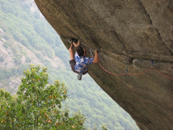 Tom Randall carrying out the third ascent of Greenspit, Valle del Orco, Italy