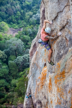 Jonas Wallin redpointing pitch 6 of 'Fever Dreams', Mumbar cliff,  Dragon Horns massif, Tioman island, Malaysia