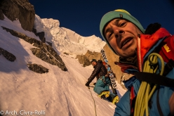 Major Route Mont Blanc: after climbing for 6 hours through total darkness the sun rises. We're immediately below the the gigantic seracs that bar the way to the summit plateau. The moment has come for the final push