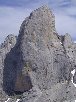The west face of Picu Urriellu, more commonly referred to as Naranjo de Bulnes in the Picos de Europa massif in Spain, and the line of Orbayu (8c+/9a 510m) put up by Iker Pou and Eneko Pou in August 2009