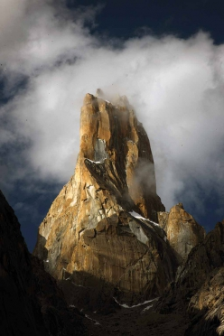 The West Face of Nameless Tower, also referred to as Trango Tower, Karakorum, Pakistan. Eternal Flame runs up the right skyline of the tower, which is actually its south buttress. The first ascent of Trango Tower was carried out in 1976 by Mo Anthoine, Martin Boysen, Joe Brown and Malcolm Howells.