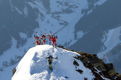 Pierra spectacle: exitining onto the crest with crampons on, skis strapped to rucksacks.