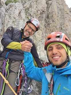 Bastava un Piumino, Brenta Dolomites: Gianluca Beliamoli and Andrea Simonini on the summit of Pilastro Canino
