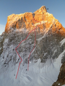 The line of the 2015 attempt, carried out by Scott Adamson and Kyle Dempster, up the North Face of Ogre II, Pakistan. The north face of Ogre II. (1) The Adamson- Dempster attempt. (2) The descent route, with (R) marking the site of the anchor failure.