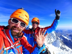 Didier Jourdain and Max Bonniot on the summit of Siula Grande, Peru, after having climbed the virgin East Face