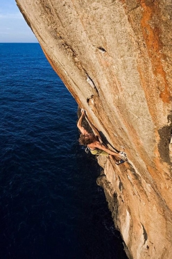 Chris Sharma making the first ascent of Alasha, a difficult new DWS on Mallorca