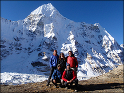 The impressive North Face of Chang Himal (6750m). Back row: Graham Desroy, Mandi Shipton, Andy Houseman. Front row: Nick Bullock, Tom Briggs.