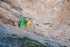 Alexander Huber making the first free ascent of 'Sueños de Invierno' (540m, 8a) on Picu Urriellu, Spain