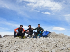 Paolo Baroldi, Filippo Mosca and Francesco Salvaterra on the summit after having made the first ascent of Pilastro Nord, Cima Tosa, Brenta Dolomites
