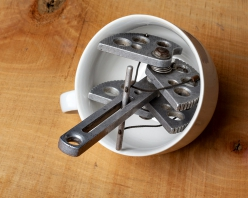 The first rigid stem Friend owned by Maurizio Oviglia, wedged into a mug
