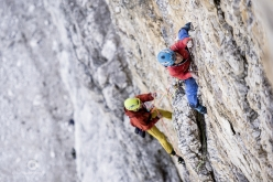 Simon Gietl, belayed by Davide Prandini, climbing 'Das Erbe der Väter' up the North Face of Cima Grande di Lavaredo, Dolomites. Gietl established this route together with Vittorio Messini