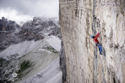 Simon Gietl climbing 'Das Erbe der Väter' up the North Face of Cima Grande di Lavaredo, Dolomites. Gietl established this route together with Vittorio Messini