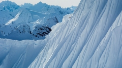 Ralph Backstrom snowboarding the fabled Corrugated spine lines of the Tsirku Glacier.