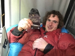 Adam Ondra eating the chocolate Heinz Zak gave to him on the second day of his push up Dawn Wall, El Capitan, Yosemite on 14/11/2016