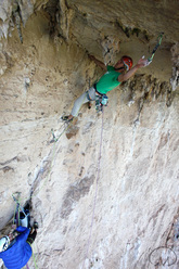 Albert Leichtfried climbing through the crux roof of La lingua pura (7c 200m), Monte Monaco, Sicily