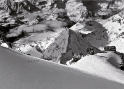 Ski touring, steep skiing: alpinists seen from the summit of Gran Paradiso
