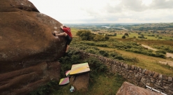 Ned Feehally mantling up Ned Zepplin 8A at the Roaches, UK