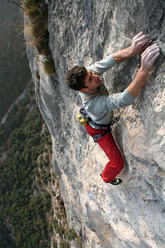 Geremia Vergoni climbing the 5th pitch of Ultima Fiamma, Piccolo Dain, Valle del Sarca, Italy