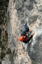 Tiziano Buccella climbing the 5th pitch of Ultima Fiamma, Piccolo Dain, Valle del Sarca, Italy