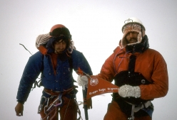 On the summit, during the historic first ascent of Cerro Murallon in Patagonia, carried out in 1984 by the Ragni di Lecco climbers Carlo Aldè, Casimiro Ferrari and Paolo Vitali.