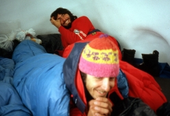 Carlo Aldè and Paolo Vitali in the snow hole, during the historic first ascent of Cerro Murallon in Patagonia, carried out in 1984 with Casimiro Ferrari
