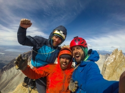 Siebe Vanhee, Sean Villanueva and Nicolas Favresse celebrate on the summit of  Central Tower of Paine in Patagonia, after having climbed 'El Regalo de Mwono' up the mountain's East Face.