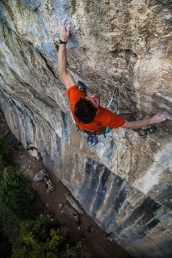 Stefano Ghisolfi making the first ascent of Omen Nomen 8c+ at the crag Padaro, Arco