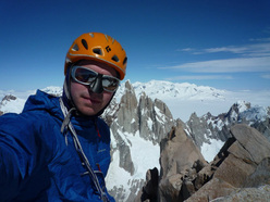 Colin Haley on the summt of Aguja Poincenot, Fitz Roy, Patagonia.