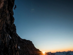 Alexander Huber establishes a pitch in last light and fixes the rope before descending to the bivouac, during the first ascent of Schweizernase on the North Face of the Matterhorn