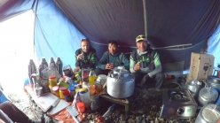 Ueli Steck, Nima-Gelu and Tenji Sherpa in the kitchen at Everest Base Camp